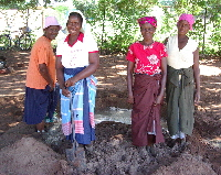 Limpopo - Ka-Mingha, women mixing mud for the bricks