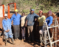 Limpopo - Ga-Mampa, building crew posing at end of the day's work